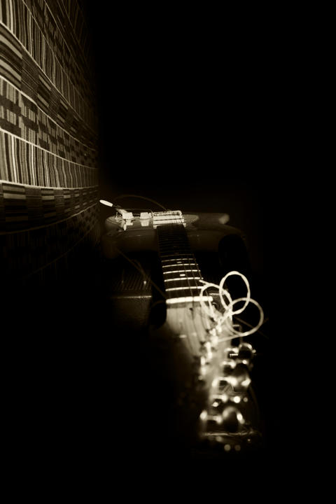 Electric Guitar Resting On Amplifire In Music Studio Foto