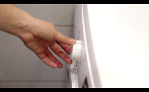 The hand includes a program at the washing machine. Clean concept Footage