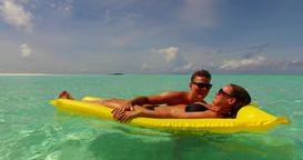 v13907 two 2 people inflatable sunbed romantic young people couple with drone Live Action