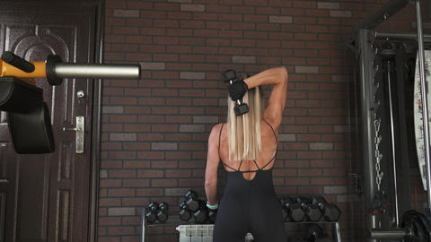 woman doing triceps exercise with dumbbells Footage