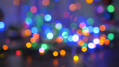 The Christmas garland is flashing with colored lights. Beautiful fuzzy Image