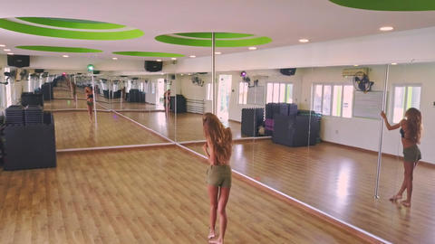 Backside View Girl Comes to Pole and Straights Long Hair Live Action