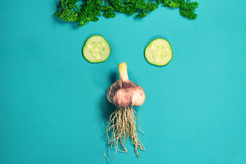 Vegetable funny face. Fresh organic Vegetables on Wooden table Photo