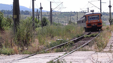 Train approaches a station after a long journey through the hills 17 Footage