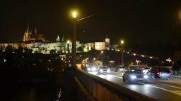 night city - night urban street - Prague castle with bridge - cars and vintage t Footage
