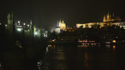 Night Charles bridge with Prague Castle (Hradcany) - river Vltava - lamps (light Footage
