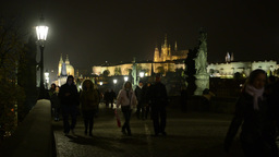 night city (buildings) - Charles bridge with people walking - Prague, Czech Repu Footage