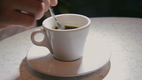 Man stirring coffee, close-up, shallow DOF Footage