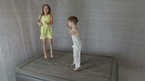 Children jump on inflatable bed Footage