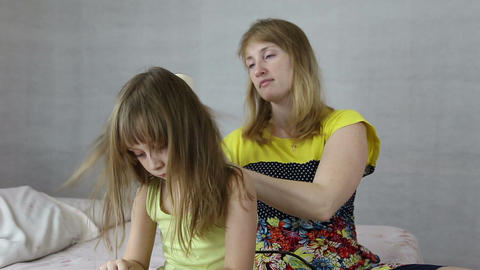 Mother dry hair hairdryer her daughter Live Action