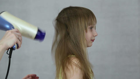 Mother dry hair hairdryer her daughter Footage