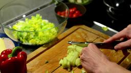 man prepares salad - man sliced cucumber Footage