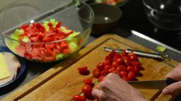 man prepares salad - man sliced tomatoes Footage