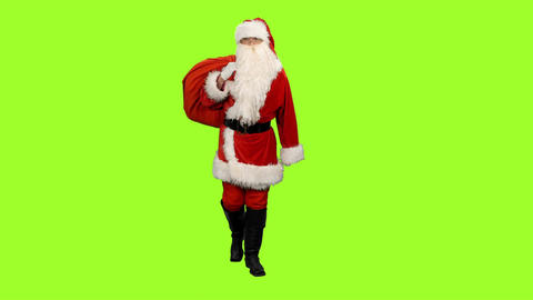 Santa Claus goes with gifts bag on green background, Chroma key Footage