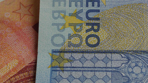 Fragment of euros banknotes. Abstract background. Close up Footage