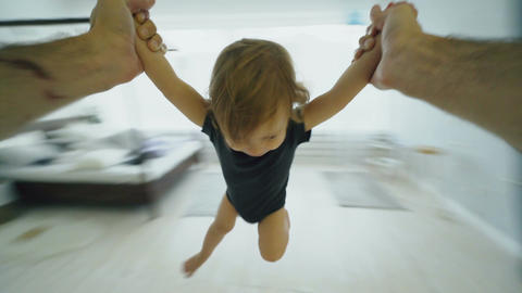 Point of View shot of Little smiling girl turning around by her father at home Footage