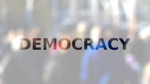 DEMOCRACY inscription on the frosted glass against crowded street Footage