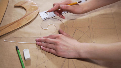 The engineer draws on a paper with a pencil, tailor makes pattern for seawing Archivo