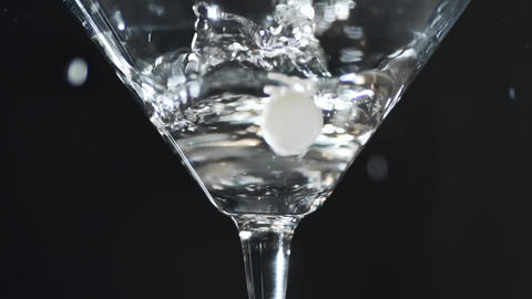 Olive falls into a glass with martini in slow motion, 240 frames per second Footage