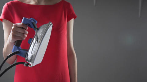 Seamstress is ironing clothes with iron, ironing with steam, handmade closes and Footage