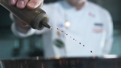 Chef adds olive oil to the dish, cooking in slow motion, falling liquid in 240 Footage