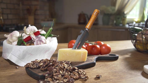 Still life with cheese and nuts, cooking food, food on the kitchen table Footage