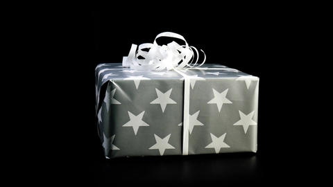 Christmas gift rotate against black background Footage