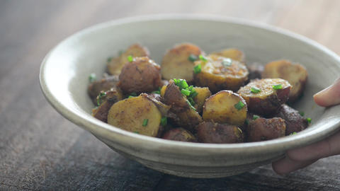 Delicious roasted potatoes is serving Live Action
