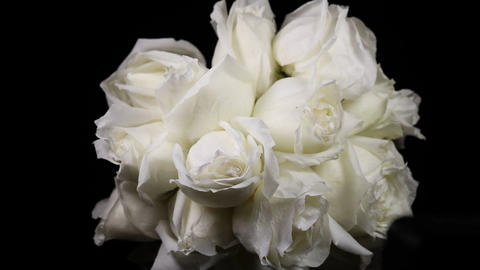 a bundle of white roses Slowly revolving Live Action