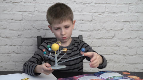 Little boy studying astronomy Footage