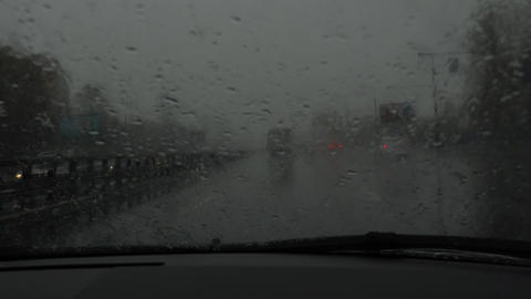 Driving in bad weather conditions. Sleet on highway. View through the windshield Footage