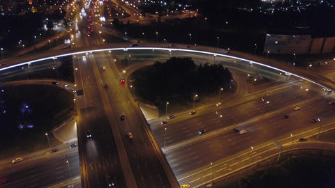 Aerial: Big road junction at Moscow beltway with automobiles and night city Footage