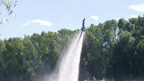 Man flies on flyboard and falls into the water through splashes Footage