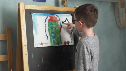 Child shows his drawing Footage