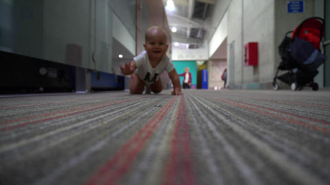 Smiling baby boy crawles on a floor. Shallow depth of field Footage