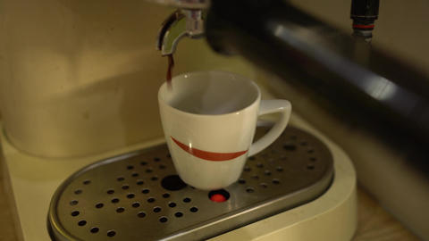 Close up of coffee machine with white cup of espresso Footage