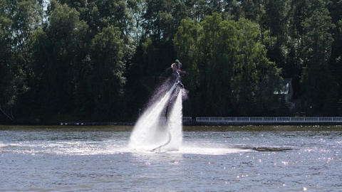 Hydroflyer makes spins on flyboard producing water splashes Footage