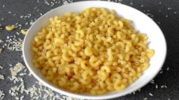 pasta - pour macaroni into plate - kitchen units Footage