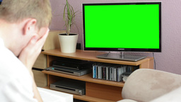 Man watches TV(television) - green screen - man expressed sadness Footage