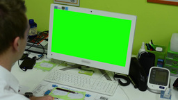 man works on computer - green screen - surgery (office) - closeup Footage