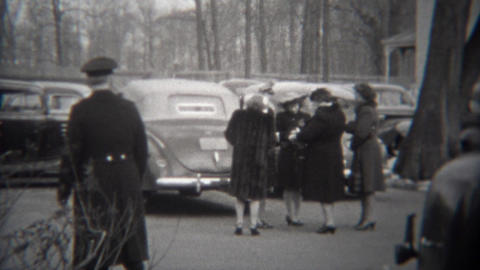 1943: Military general milling around dreading telling group of women bad news Footage