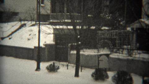 1944: American flag waves in snow covered wealthy residential neighborhood Footage
