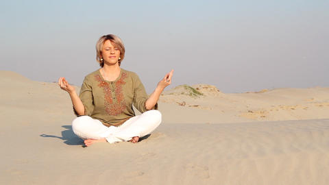 Woman Meditating In Desert stock footage
