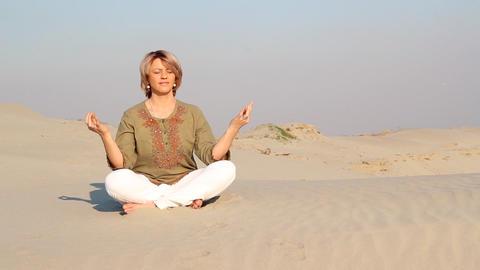Woman Meditating In Desert stock footage