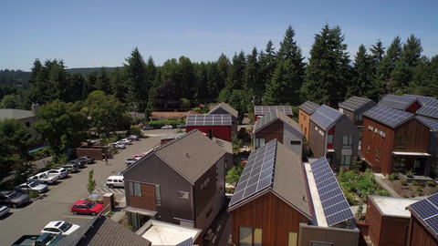 ULTRA HD 4K Aerial view of solar panels on building rooftops - Bainbridge Island Footage