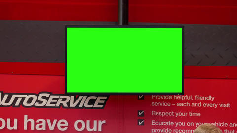 Motion of green screen tv at auto service counter inside Canadian tire store Footage