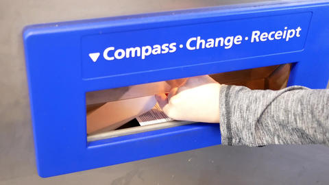 Motion of people buying compass card and taking receipt with 4k resolution Footage