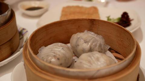 Motion of steamed prawn dumplings with steam inside Grand Hyatt Taipei Live Action