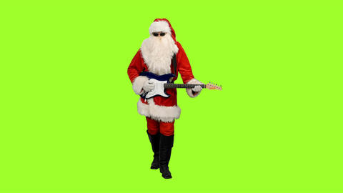 Santa Сlaus stepping and playing guitar on green screen background Archivo