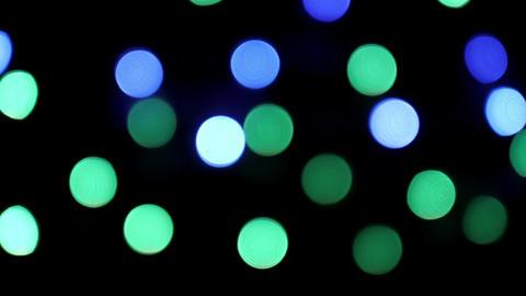 Colorful blinking Christmas bokeh lights on black background looped ビデオ